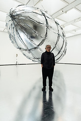 © Licensed to London News Pictures. 29/05/2018. London, UK. South Korea artist LEE BUL stands next to her  large scale installation titled Willing To Be Vulnerable - Metalized Balloon, (2015-2016) resembling a Hindenbug airship. The exhibition spans the artists career and is showing at the Haywood Gallery. Photo credit: Ray Tang/LNP