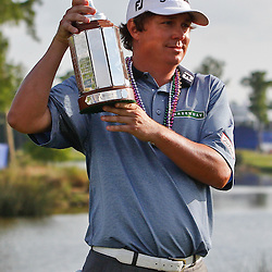Apr 29, 2012; Avondale, LA, USA; Jason Dufner holds the championship trophy after a win in the final round of the Zurich Classic of New Orleans at TPC Louisiana. Mandatory Credit: Derick E. Hingle-US PRESSWIRE