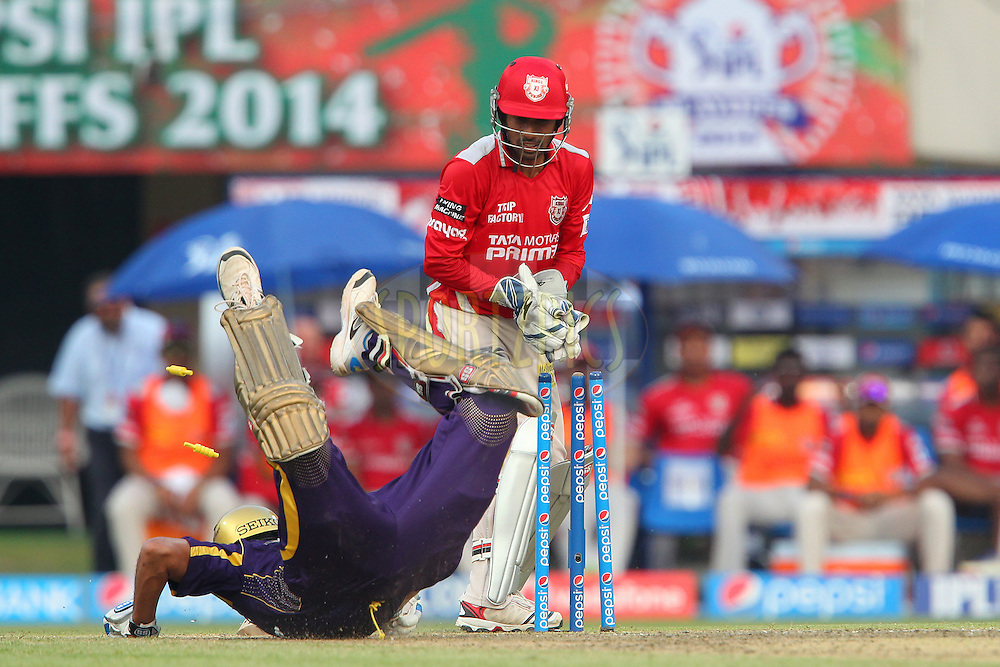 Wriddhiman Saha of the Kings X1 Punjab tries to run out Yusuf Pathan during the first qualifier match (QF1) of the Pepsi Indian Premier League Season 2014 between the Kings XI Punjab and the Kolkata Knight Riders held at the Eden Gardens Cricket Stadium, Kolkata, India on the 28th May  2014<br /> <br /> Photo by Ron Gaunt / IPL / SPORTZPICS<br /> <br /> <br /> <br /> Image use subject to terms and conditions which can be found here:  http://sportzpics.photoshelter.com/gallery/Pepsi-IPL-Image-terms-and-conditions/G00004VW1IVJ.gB0/C0000TScjhBM6ikg
