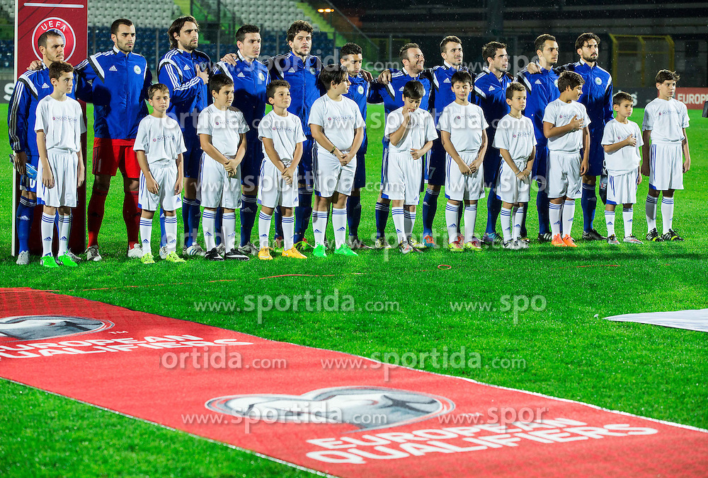 Players of San Marino listening to the national anthem during football match between National teams of San Marino and Slovenia in Group E of EURO 2016 Qualifications, on October 12, 2015 in Stadio Olimpico Serravalle, Republic of San Marino. Photo by Vid Ponikvar / Sportida