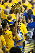A Golden State Warriors cheerleader gets the crowd excited during Game 2 of the Western Conference Semifinals against the Utah Jazz at Oracle Arena in Oakland, Calif., on May 4, 2017. (Stan Olszewski/Special to S.F. Examiner)