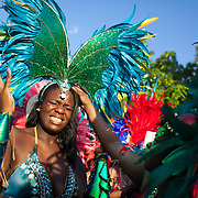 A dancer feels the pinch from her head gear and sqirms in agony. The Notting Hill Carnival has been running since 1966 and is every year attended by up to a million people. The carnival is a mix of amazing dance parades and street parties with a distinct Caribbean feel.