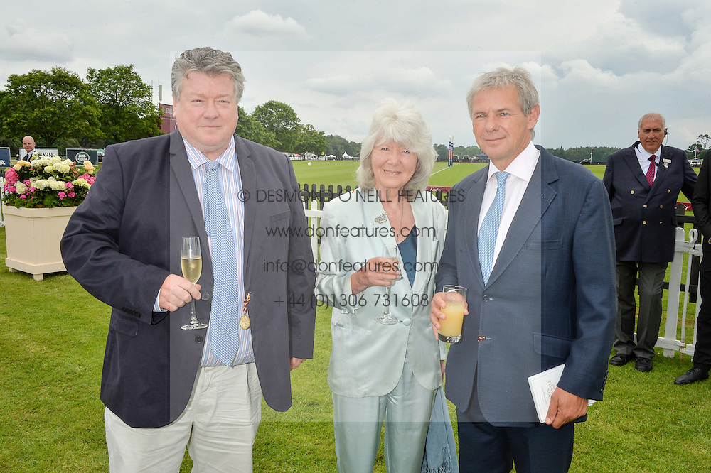 Left to right, FELIX COOPER, his mother JILLY COOPER and CHARLIE GORDON-WATSON at the Cartier Queen's Cup Final 2016 held at Guards Polo Club, Smiths Lawn, Windsor Great Park, Egham, Surry on 11th June 2016.