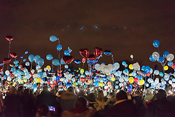 © Licensed to London News Pictures. 02/02/2018. LONDON, UK.  Family, friends and wellwishers release dozens of lit balloons into the night sky at Harefield Green in north west London in memory of teenagers Harry Louis Rice, 17, George Toby Wilkinson, 16 and Josh McGuinness, 16.  The tribute marks seven days since the teenagers lost their lives in the Hayes car crash and the release of the balloons, timed for 8.40pm, marks the time of the crash.   Photo credit: Stephen Chung/LNP