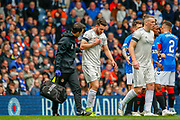 Connor McLennan of Aberdeen FC has to be helped off the park during the Ladbrokes Scottish Premiership match between Rangers and Aberdeen at Ibrox, Glasgow, Scotland on 27 April 2019.