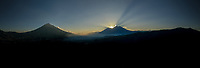 Aerial panorama of sunset with volcanoes (from left) Agua, Fuego and Acatenango near Antigua, Guatemala on Dec. 31, 2018.