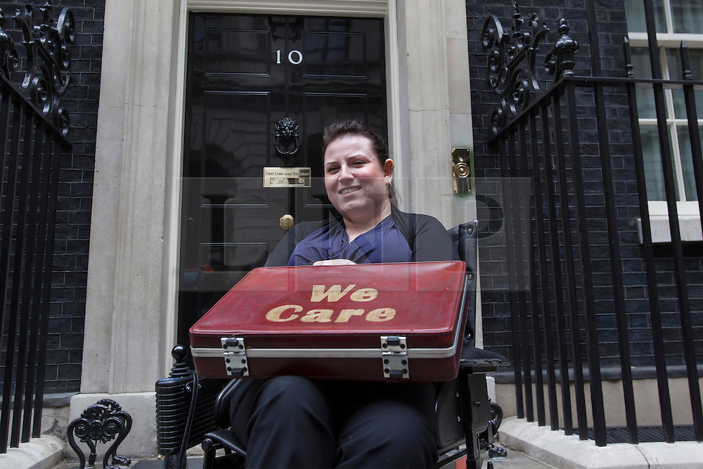 © licensed to London News Pictures. London, UK 24/06/2013. Angela Murray, 29, a psychology graduate from Luton, delivering a petition with 45,000 signatures to Downing Street calling on the Government to urgently invest in local support for disabled people. Photo credit: Tolga Akmen/LNP