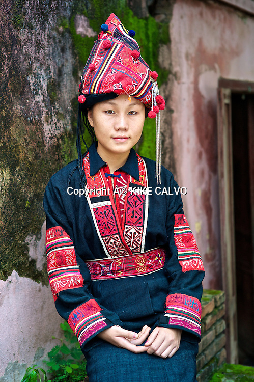 Teen wearing a Aka Oma traditional dress, commonly found in Phon Sali Province.