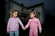Kacey and Lacey Sellers, 4, are identical twins that were both born deaf. Their disability wasn't discovered until the age of two when their parents became worried that neither had yet spoken. Their father Jesse was an ironworker at the time and cashed in big on his health insurance to pay for the $86,000 per girl cochlear implant surgery. Now, a year and a half after the surgery the girls are on the same comprehension level as a newborn. (MATT EICH)