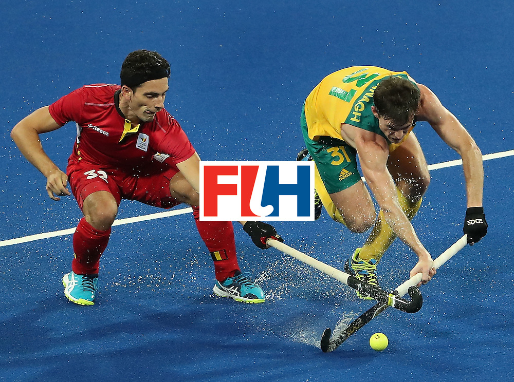 RIO DE JANEIRO, BRAZIL - AUGUST 09:  Fergus Kavanagh #31 of Australia pushes the ball past Tanguy Cosyns #32 of Belgium during the hockey game on Day 4 of the Rio 2016 Olympic Games at the Olympic Hockey Centre on August 9, 2016 in Rio de Janeiro, Brazil.  (Photo by Christian Petersen/Getty Images)