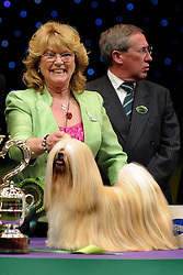 © Licensed to London News Pictures. 11/03/2012. Margaret Anderson from Coventry and her dog Elizabeth are crowned the Best in Show at the 2012 Crufts final at the Birmingham NEC Arena. Photo credit: Alison Baskerville/LNP