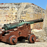 Cannon at Castillo San Felipe de Barajas in Cartagena, Colombia <br /> After the expansion of Castillo San Felipe de Barajas was complete in the mid-17th century, it was armed with 63 cannons.  Most of them are gone but a few remain along the upper bulwark next to a watch tower.  These mortars were very effective against the British in 1741.  The Spanish called it the Defeat of the British Armada.  Although outnumbered by almost ten to one, the Cartagenans sunk six Royal Navy ships and damaged 17 others.