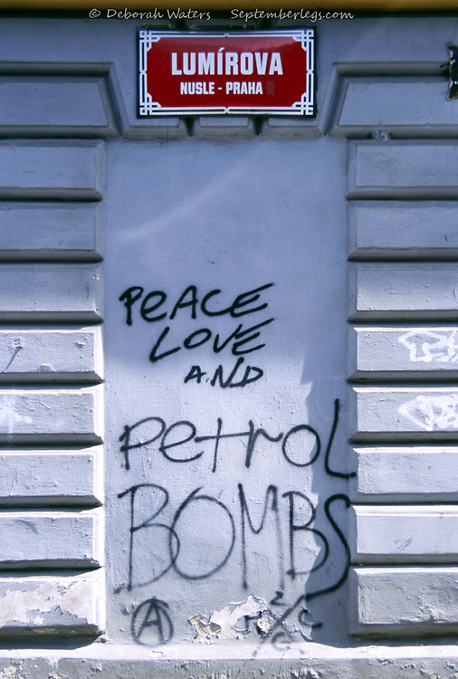 Peace Love and Petrol Bombs, graffiti written in a white wall alcove on  Lumirova, Prague, Czech Republic