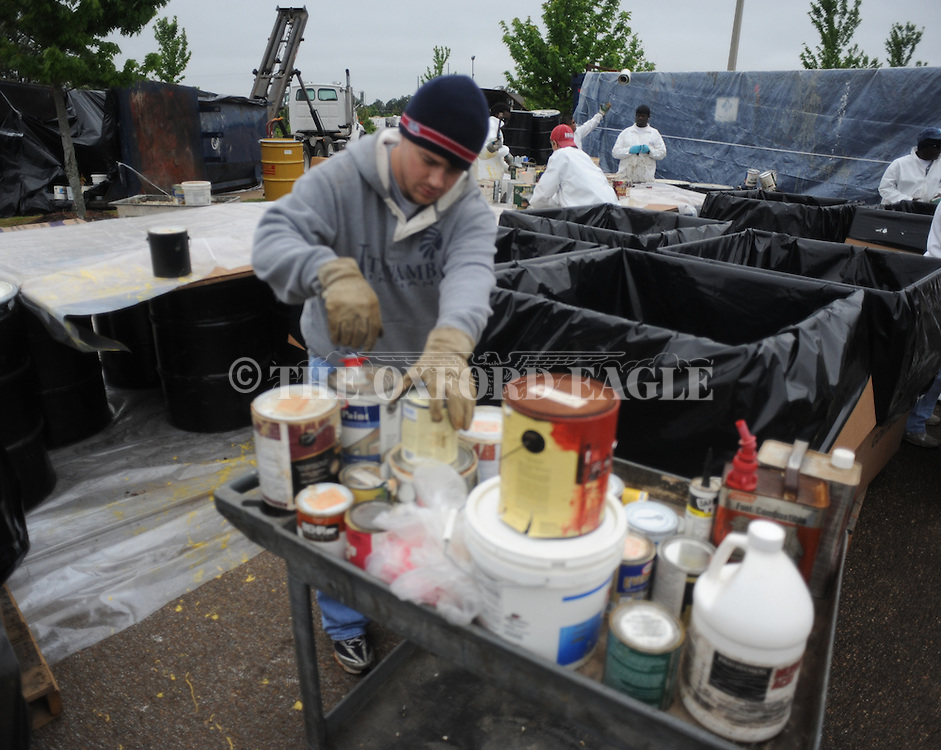Casey Franks collects paint being dropped off during Household Hazardous Waste Collection Day in Oxford, Miss. on Saturday, April 21, 2012.