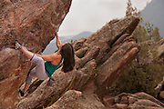 Professional boulderer Alex Puccio bouldering on Flagstaff Mountain near Boulder Colorado.