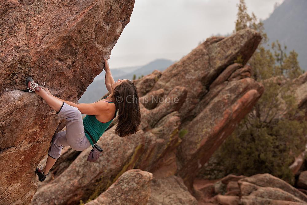 Professional boulderer Alex Puccio bouldering on Flagstaff Mountain near Boulder Colorado.