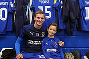 AFC Wimbledon attacker Marcus Forss (15), Mascot during the EFL Sky Bet League 1 match between AFC Wimbledon and Lincoln City at the Cherry Red Records Stadium, Kingston, England on 2 November 2019.