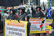 "Orthodox Jews of Neturei Karta who refuse to recognize the existence of a so-called ""State of Israel"", leading the way to the event, rue Sainte-Catherine."