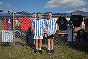 Young Programme sellers before the FA Vase 1st Qualifying Round match between Worthing United and East Preston FC at the Robert Eaton Memorial Ground, Worthing, United Kingdom on 6 September 2015. Photo by Phil Duncan.