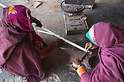 Women working metal bars for parabolic solar cooker. A craft that has traditionally been synonymous with men, work metal is today being practiced by Rajasthan villages women. 01/2013 © Marida Augusto/Max Hirzel