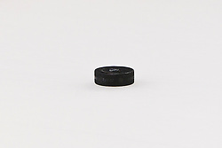 Nov 10, 2011; San Jose, CA, USA; Detailed view of a hockey puck on the ice before the game between the San Jose Sharks and the Minnesota Wild at HP Pavilion.  San Jose defeated Minnesota 3-1. Mandatory Credit: Jason O. Watson-US PRESSWIRE