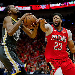 May 6, 2018; New Orleans, LA, USA; New Orleans Pelicans forward Anthony Davis (23) knocks a ball away from Golden State Warriors forward Kevin Durant (35) during the first quarter in game four of the second round of the 2018 NBA Playoffs at the Smoothie King Center. Mandatory Credit: Derick E. Hingle-USA TODAY Sports