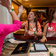 WASHINGTON,DC - MAR20: Margaret Johnson, a Sweet Briar College alumna, cheers after she counted out $1100 dollars raised for Sweet Briar, at a pop-up fundraiser at Mission in Dupont Circle, to save the womens' college in Virginia, which will close if it can't raise $250 million dollars, March 20, 2015. (Photo by Evelyn Hockstein/For The Washington Post)