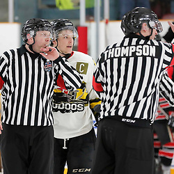 TRENTON, ON  - MAY 5,  2017: Canadian Junior Hockey League, Central Canadian Jr. &quot;A&quot; Championship. The Dudley Hewitt Cup. Game 7 between The Georgetown Raiders and The Powassan Voodoos. OHA Referees make the call during the third period <br /> (Photo by Amy Deroche / OJHL Images)