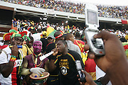Fans taking photographs of Ghanian 'Ju-Ju' medicine man casting spells over the Moroccan opposition during halftime.  Ghana V Morocco. African Cup of Nations 2008. Ohene Djan Stadium. Accra. Ghana. West Africa..28th January 2008..©Picture Zute Lightfoot.  07939 108077. www.lightfootphoto.co.uk