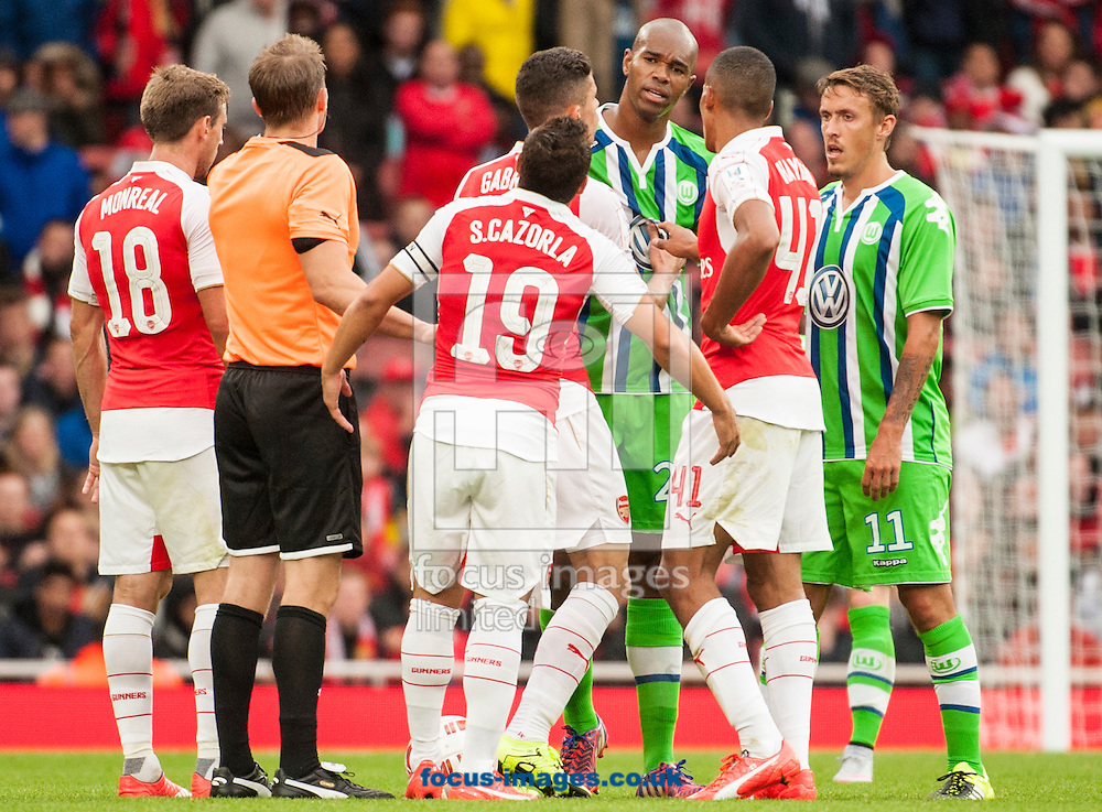 Naldo of Wolfsburg confronts Santi Cazorla of Arsenal  during the Emirates Cup match at the Emirates Stadium, London.<br /> <br /> Picture by Jack Megaw/Focus Images Ltd <br /> +44 7481 764811<br /> 26/07/2015