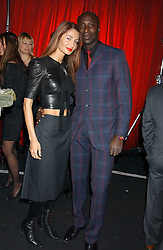 Fashion designer OZWALD BOATENG and his wife GYUNEL at a party to celebrate the first issue of British Harper's Bazaar held at Cirque, 10-14 Cranbourne Street, London WC2 on 16th February 2006.<br />