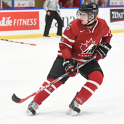 WHITBY, - Dec 13, 2015 -  WJAC Game 2- Team Switzerland vs Team Canada East at the 2015 World Junior A Challenge at the Iroquois Park Recreation Complex, ON. Derek Topatigh #6 of Team Canada East follows the play during the first period.<br /> (Photo: Andy Corneau / OJHL Images)