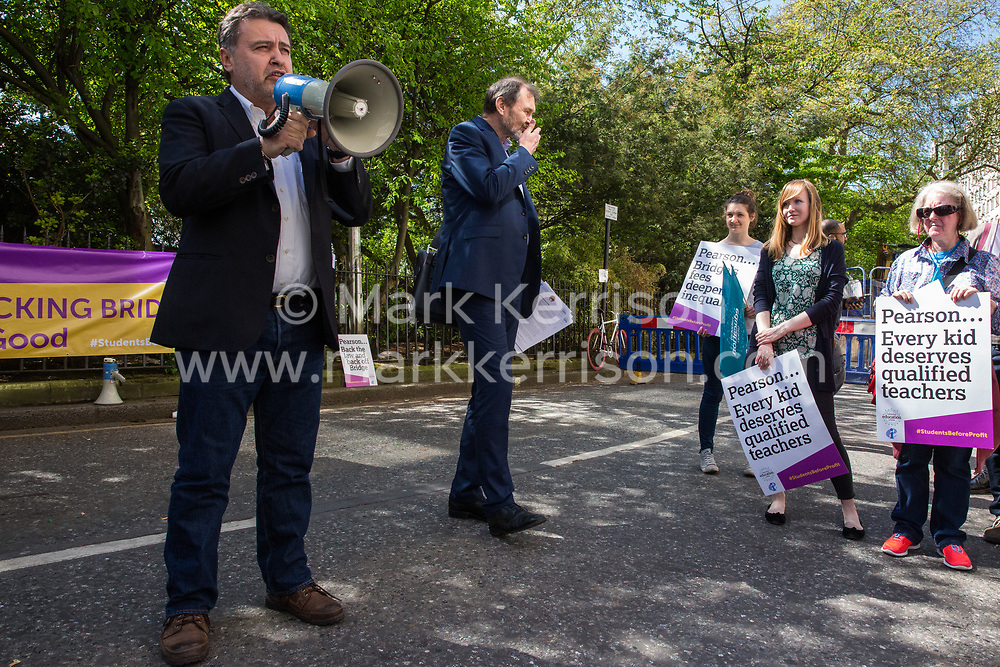 London, UK. 4th May, 2018. Angelo Gavrielatos, Project Director at Education International (EI), addresses members of the National Education Union (NEU) demonstrating outside the AGM of multinational assessment service Pearson in protest against investment by the corporation in 'low-fee' private schools provider Bridge. Bridge, one of the world's largest education-for-profit companies, aims to extend its influence throughout Africa and Asia.