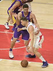 November 27, 2017 - Los Angeles, California, U.S - Blake Griffin #32 of the Los Angeles Clippers is defended by Brook Lopez #11 of  the Los Angeles Lakers during their game on Monday November 27, 2017 at the Staples Center in Los Angeles, California. Clippers vs Lakers. (Credit Image: © Prensa Internacional via ZUMA Wire)