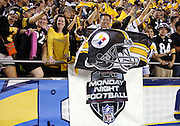 Pittsburgh Steelers fans wave yellow terrible towels and a team flag as they stand above an ESPN Monday Night Football banner during the Pittsburgh Steelers 2015 NFL week 5 regular season football game against the San Diego Chargers on Monday, Oct. 12, 2015 in San Diego. The Steelers won the game 24-20. (©Paul Anthony Spinelli)