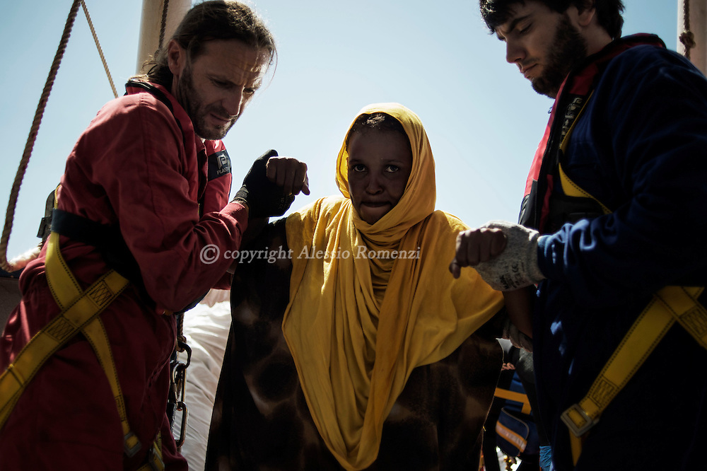 Italy: MSF Dignity1: A Somali pregnant woman rescued at the sea is helped to get on the Dignity1 on August 23, 2015. Alessio Romenzi