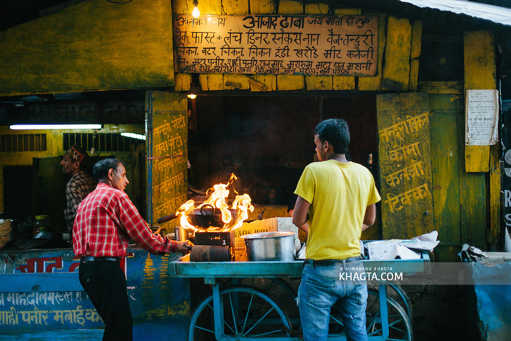 Owner of Azad Dhaba, a small eating joint lights up his stove to make sweets for the festival day at Dhalpur Ground. Kullu Dussehra is the Dussehra festival observed in the month of October in Himachal Pradesh state in northern India. It is celebrated in the Dhalpur maidan in the Kullu valley. Dussehra at Kullu commences on the tenth day of the rising moon, i.e. on 'Vijay Dashmi' day itself and continues for seven days. Its history dates back to the 17th century when local King Jagat Singh installed an idol of Raghunath on his throne as a mark of penance. After this, god Raghunath was declared as the ruling deity of the Valley.