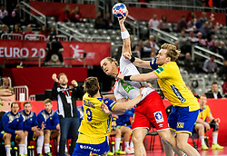 Kent Robin Tonnesen of Norway between Jerry Tollbring of Sweden and Max Darj of Sweden during handball match between National teams of Sweden and Norway on Day 7 in Main Round of Men's EHF EURO 2018, on January 24, 2018 in Arena Zagreb, Zagreb, Croatia.  Photo by Vid Ponikvar / Sportida