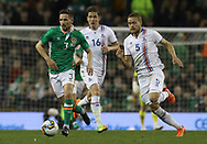 Conor Hourihane of Republic of Ireland and Sverrir Ingi Ingason of Iceland during the International Friendly match at the Aviva Stadium, Dublin<br /> Picture by Lorraine O'Sullivan/Focus Images Ltd +353 872341584<br /> 28/03/2017