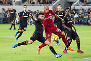 LAFC forward Diego Rossi (9) battles against Toronto FC defender Auro (96) during an MLS soccer game between the LAFC and the Toronto FC. LAFC and Toronto FC tied 1-1 on Saturday, Sept 21, 2019, in Los Angeles. (Ed Ruvalcaba/Image of Sport)