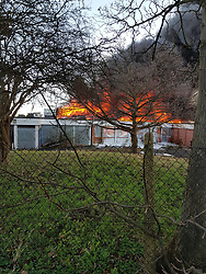 © Licensed to London News Pictures. 18/12/2017. Newhaven, UK. Fire has broken out in the old Grays School building in Newhaven, East Sussex. Photo credit: Hugo Michiels/LNP