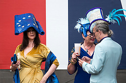 © Licensed to London News Pictures. 19/06/2018. London, UK. A racegoer in an anti Brexit outfit and hat attends day one of Royal Ascot at Ascot racecourse in Berkshire, on June 19, 2018. The 5 day showcase event, which is one of the highlights of the racing calendar, has been held at the famous Berkshire course since 1711 and tradition is a hallmark of the meeting. Top hats and tails remain compulsory in parts of the course. Photo credit: Ben Cawthra/LNP