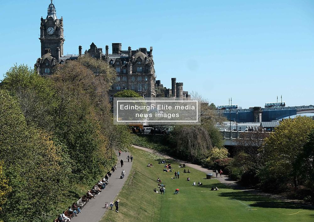 Edinburgh Weather, Wednesday 3rd May 2017<br />  <br /> Tourists and locals enjoy the sunshine in Princes Street Gardens, Edinburgh today<br /> <br /> (c) Alex Todd | Edinburgh Elite media