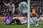 Fikayo Tomori (Derby County) looks on as two attempts at goal by Oliver Watkins (Brentford) & Neal Maupay (Brentford) fail during the EFL Sky Bet Championship match between Brentford and Derby County at Griffin Park, London, England on 6 April 2019.