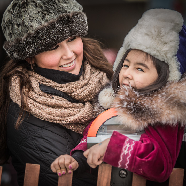 """Robin Demoski and her Daughter, Dahae Chris, at the Rondy World Championship Sled Dog Races during Anchorage's Winter Carnival  """"I grew up in Barrow but have lived in Anchorage for ten years.  I like the fact that Anchorage has so many wonderfull events, like Rondy.""""  rdemoski@gmail.com"""