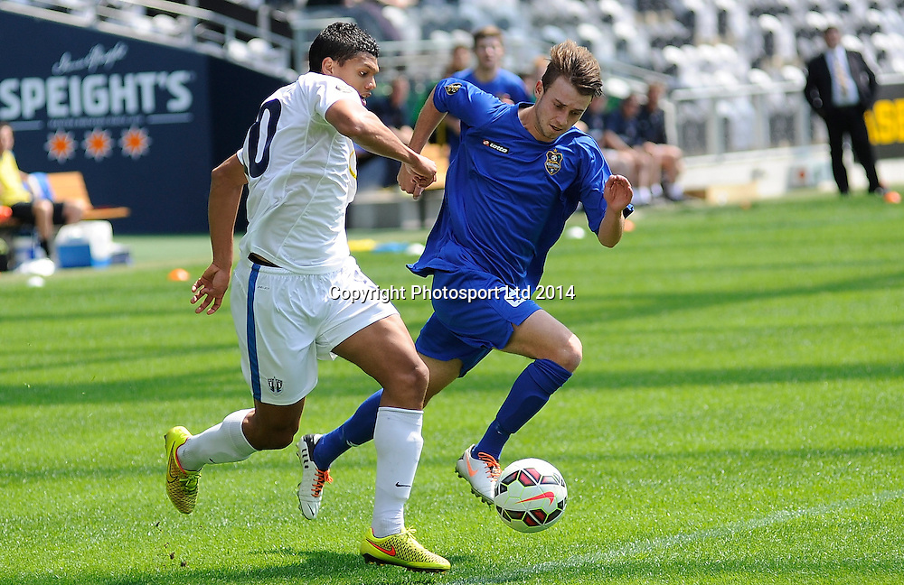 Ryan De Vries of Auckland City & Nick Hindson of Southern contend for the ball during the ASB Football Premiership, Southern v Auckland, 25 October 2014, Forsyth Barr Stadium Dunedin,  New Zealand. Photo: Richard Hood/photosport.co.nz