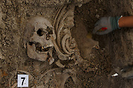 24/09/2017. Archeologist work at a mass grave known as 'La Fosa de los Maestros' (The teachers' mass grave) containing the bodies of 7 people in a field in Cobertelada on September 24, 2017 near Almazan, in Soria province, Spain. The seven people where allegedly assassinated on August 25, 1936 after being take from prison of Almazan during the Spanish Civil War by Falangists, as part of General Francisco Franco armed forces. The remains are supposed to belong to teachers in the region, who were also friends of Spanish writer Antonio Machado. The exhumation was done by members of ARANZADI and La asociacion Soriana Recuerdo y Dignidad (ASRD) 'The Soria Association for Memory and Dignity'. Spain's Civil War took the lives of thousands of people on both sides and civilians, but Franco continued his executions after the war has finished. Teachers, as part of the education sector, were often a target of Franco's forces. Spanish governments has never done anything to help the victims of the Civil War and Franco's dictatorship while there are still thousands of people missing in mass graves around the country. (© Pablo Blazquez)