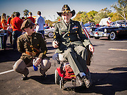"""11 NOVEMBER 2013 - PHOENIX, AZ: Generations of veterans at the Phoenix Veterans Day Parade. The Phoenix Veterans Day Parade is one of the largest in the United States. Thousands of people line the 3.5 mile parade route and more than 85 units participate in the parade. The theme of this year's parade is """"saluting America's veterans.""""    PHOTO BY JACK KURTZ"""