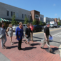 Debbie Brangenburg, center left, leads a walking tour of downtown Tupelo as Tupelo hosted several members of Mississippi Main Street Association and the Natiional Main Street Center Tuesday.