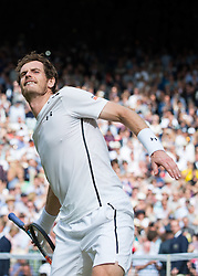 LONDON, ENGLAND - Sunday, July 10, 2016:  Andy Murray (GBR) throws his tennis racquet into the crowd after winning the Gentlemen's Singles Final match against Milos Raonic (CAN) on day fourteen of the Wimbledon Lawn Tennis Championships at the All England Lawn Tennis and Croquet Club. (Pic by Kirsten Holst/Propaganda)
